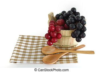 Wooden cooking utensils with bucket
