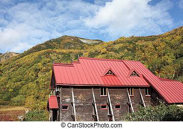 wooden cottage in autumn