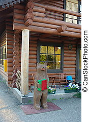 Wooden country house made of logs with chairs and table