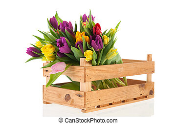 Wooden crate full with bouquet colorful tulips