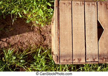 Wooden crate resting on the soil of countryside