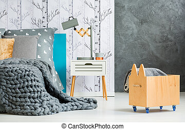 Wooden crate with blanket