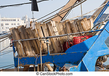Wooden crates on a fishing trawler.