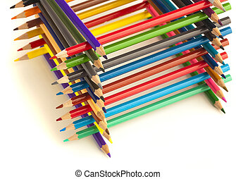 wooden crayons tower on a white background