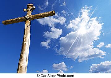 Wooden Cross Against a Blue Sky - Old wooden cross (trunks...