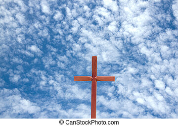 Wooden Cross Against Blue Cloudy Sky Background