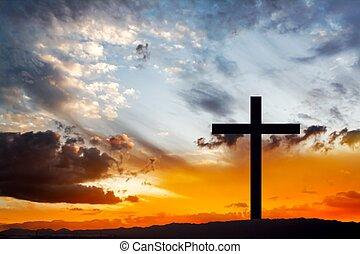 Wooden cross against sky backgroun