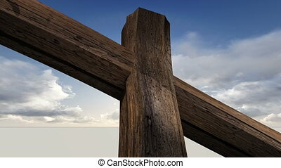 Wooden cross against the sky with clouds