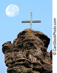 Wooden Cross against the sky with the moon