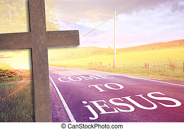 Wooden cross and a road to Jesus