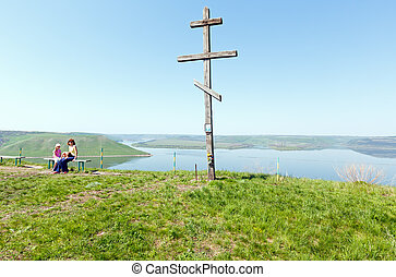 Wooden Cross and Bakota spring view (Ukraine)