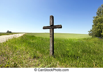 Wooden cross, close-up field