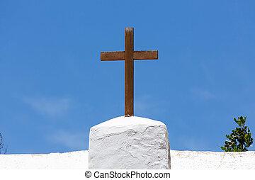 Wooden cross crucifix - Wooden cross on a white church...
