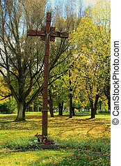 Wooden cross in the park