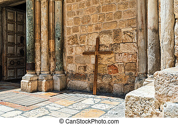 Wooden cross lean against the wall of the Holy Sepulchre church in Jerusalem.