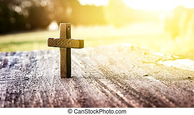 Wooden cross on background .
