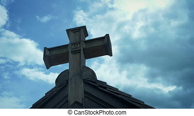 Wooden Cross On Building With Passing Clouds - Cross on ...