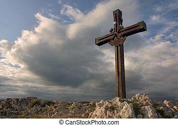 Wooden cross on mountain top