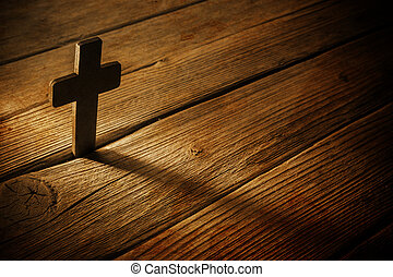 wooden cross on wood background