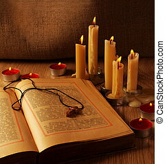Wooden Cross over Open Old Testaments