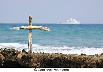 Wooden Cross (with boat) - A wooden cross out on a reef in...