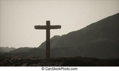 wooden Crucifix cross at mountain