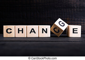 """Wooden cube flip with word """"change"""" to """"chance"""" on wood table, Personal development and career growth or change yourself concept"""