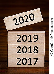 wooden cube with flip over block 2019 to 2020 word. Resolution, strategy, solution, goal, business, New Year New You and happy holiday concepts