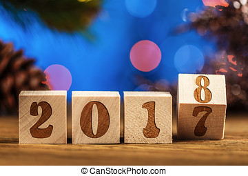 Wooden cubes 2018. Cometh the new year. Blurred background....