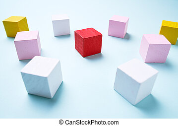 Wooden cubes blue background, business concept