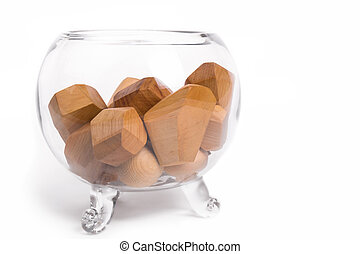 wooden cubes in a glass vase