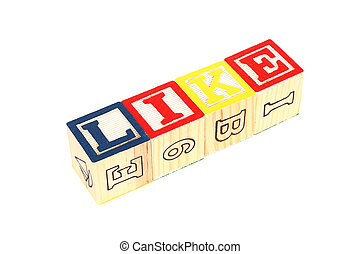 "Wooden cubes made the word ""like"" on white background"