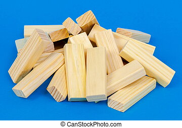 Wooden cubes pile up on a blue background