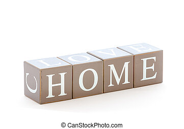 Wooden cubes wit the word home spelled