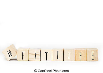 Wooden cubes with a Hashtag and the word Fitlife isolated on white background, Healthy and social media concept