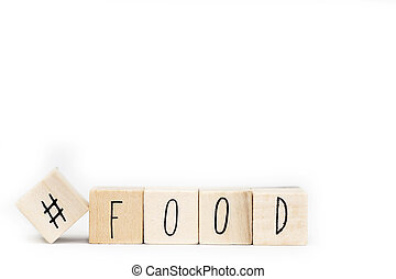 Wooden cubes with a hashtag and the word food, social media concept isolated on white background