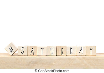 Wooden cubes with a hashtag and the word Saturday, social media concept near white background
