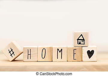 Wooden cubes with Hashtag and the word Home background, social media concept