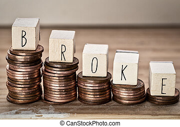 Wooden cubes with the word broke and pile of coins, money climbing stairs, business concept background