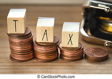 Wooden cubes with the word Tax on money climbing staits, pile of coins ,Tax Concept background