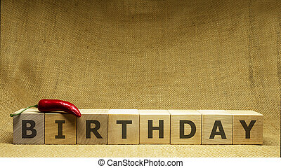 Wooden cubes with word BIRTHDAY on sackloth background. Business concept