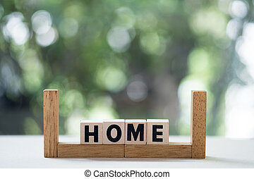 Wooden cubes with word home with copy space