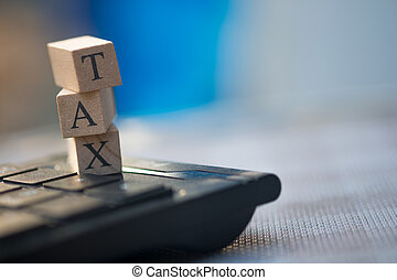 Wooden cubes with word TAX. Tax time concept