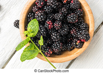 Wooden cup with Blackberries