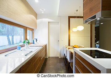 Wooden cupboards in beauty kitchen in traditional style