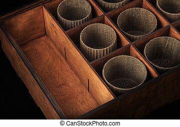 Wooden cups in a box for storing dishes