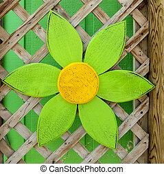 wooden daisy decoration on trellis