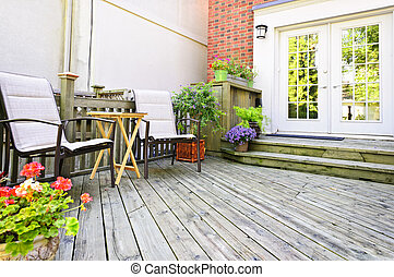 Wooden deck at home - Wooden deck on house with chairs and...