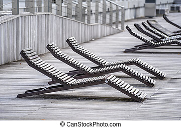 Wooden deck chairs on the promenade in Singapore Marina Bay
