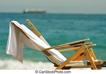 Wooden Deck Chairs Sit On Florida Beach